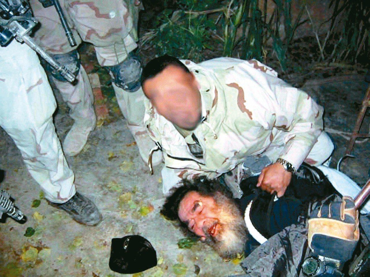 伊拉克前總統海珊2003年12月在提克里特省被美軍擒獲。 (歐新社)