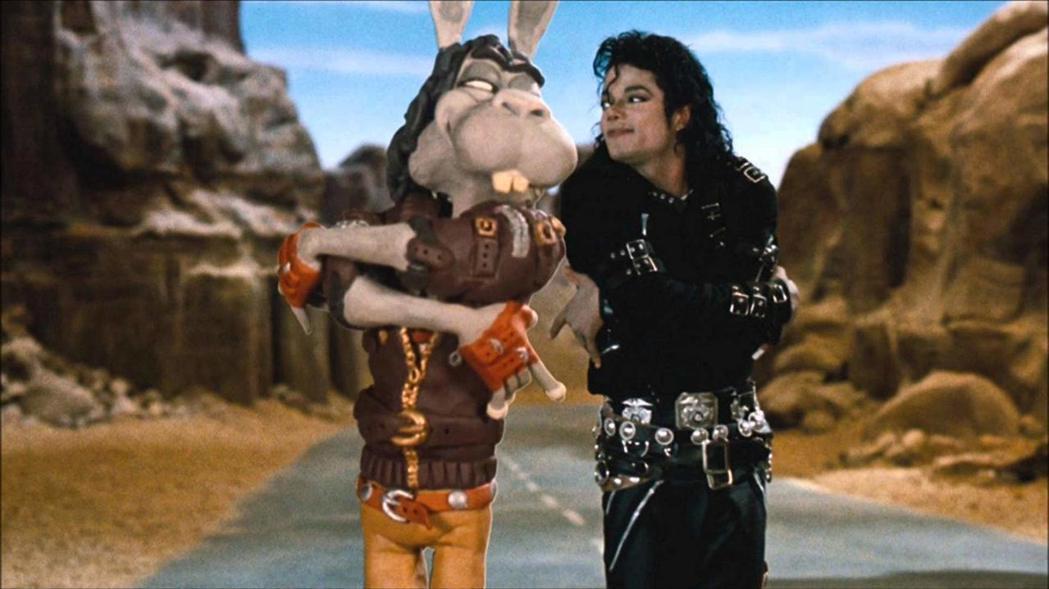 「外星戰將」運用特效讓麥可傑克森和奇特生物對戲。圖/摘自imdb