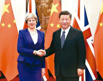 梅伊領導的英國若無協議脫歐,學者認為英國可能更積極與亞洲等國簽訂貿易協議。圖為英...
