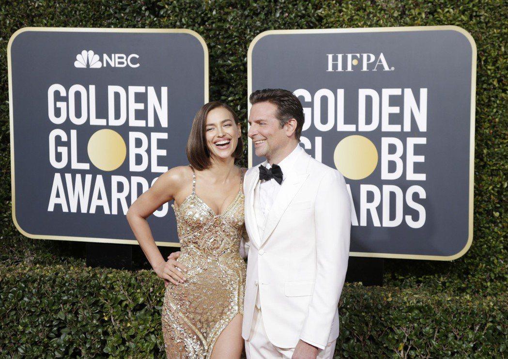布萊德利庫柏與女友艾琳娜在金球獎星光大道上不時放閃。圖/歐新社資料照片