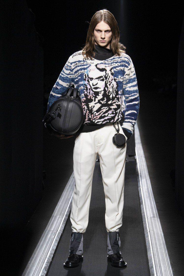 藝術家Raymond Pettibon的蒙娜麗莎頭像也琛現在針織衫上。圖/Dio...