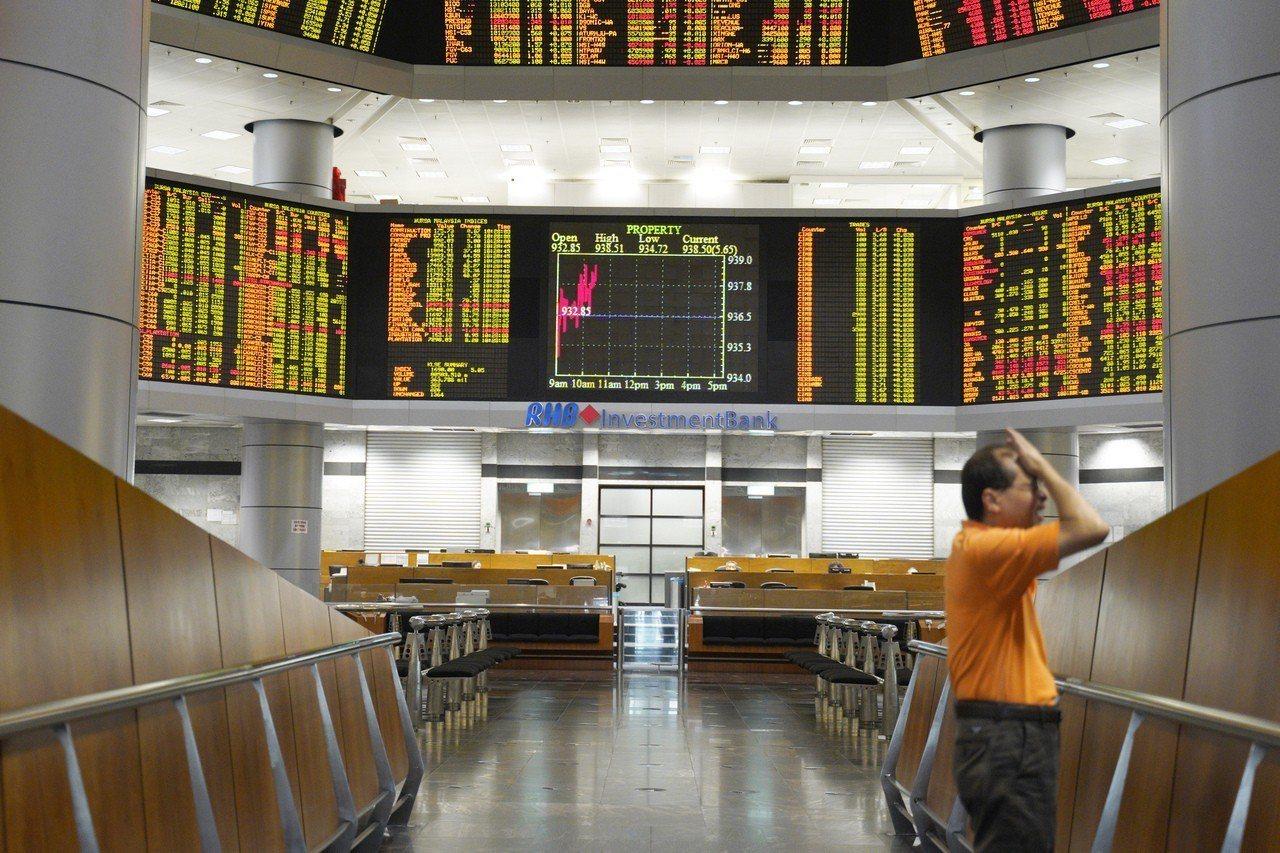 亞洲股市終結震盪一週,今天收高。 美聯社