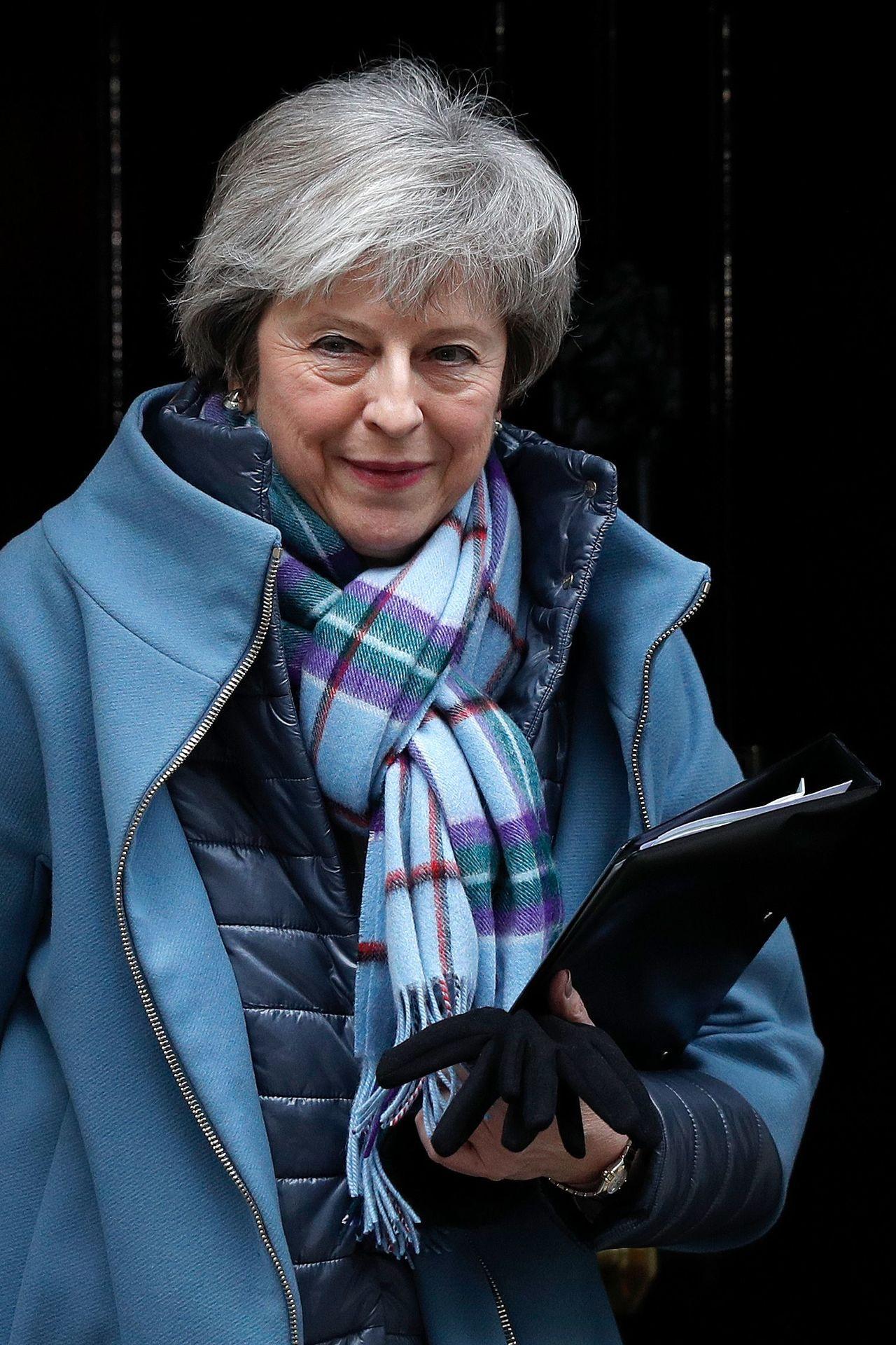 梅伊29日離開首相府前往國會。(法新社)