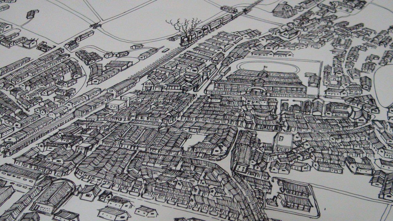 從小喜歡繪畫的吳嘉文,用心描繪出早期民雄鬧區地圖。記者謝恩得/攝影