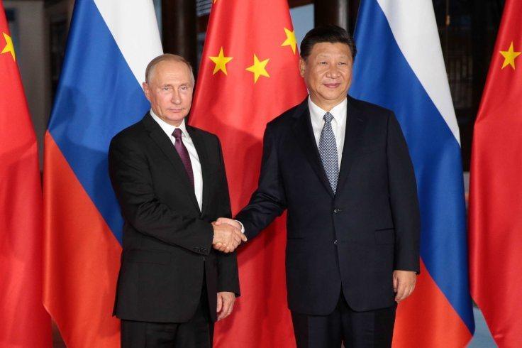 美國國防部發表報告,指中俄兩國是太空威脅。圖為俄國總統普亭(左)和大陸國家主席習...
