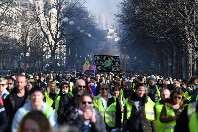 法國連續第14周上演「黃背心」抗議活動。 法新社
