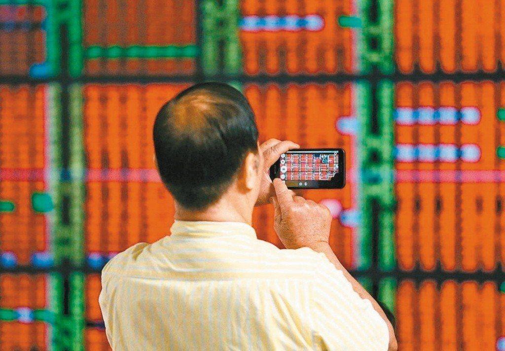 台股20日指數盤中漲逾百點,高點曾達10,266點。聯合報系資料照
