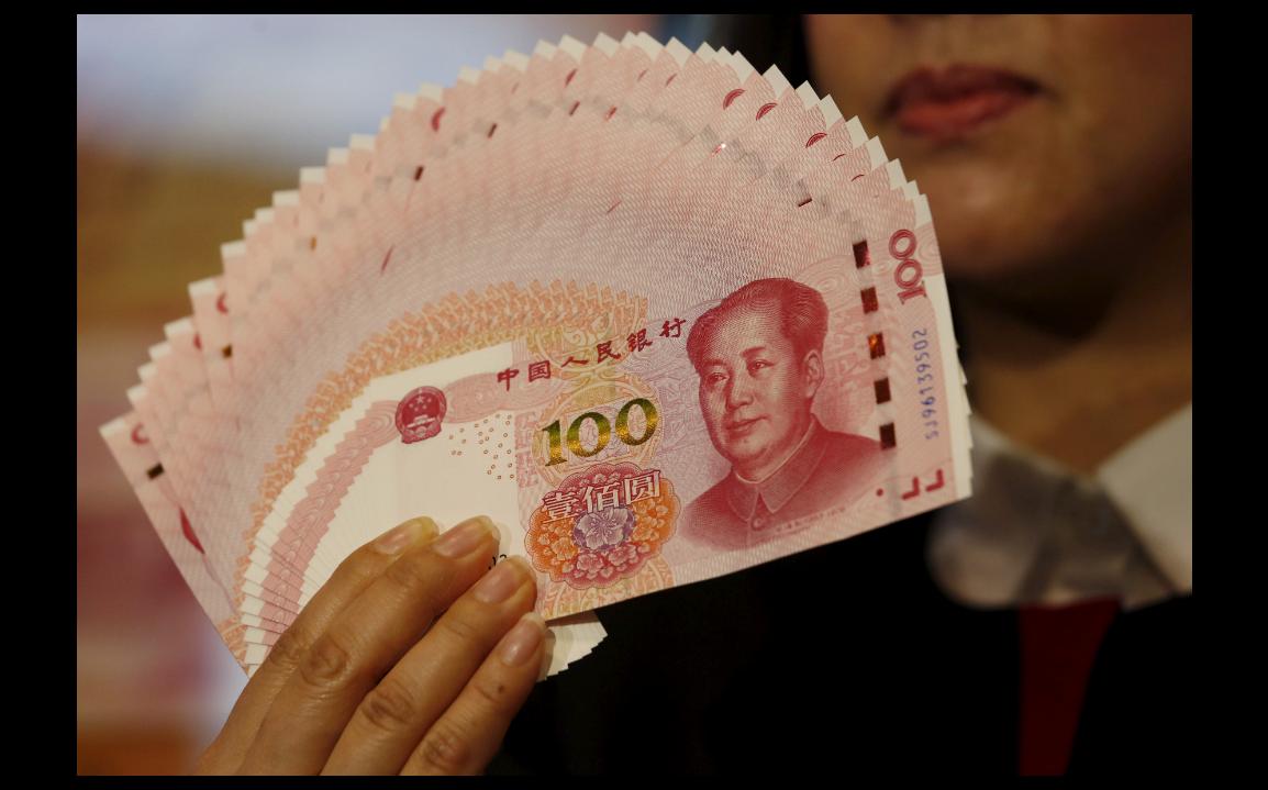 人民幣對美元20日再度走強,在岸市場開盤後不久即升破6.73。(路透)
