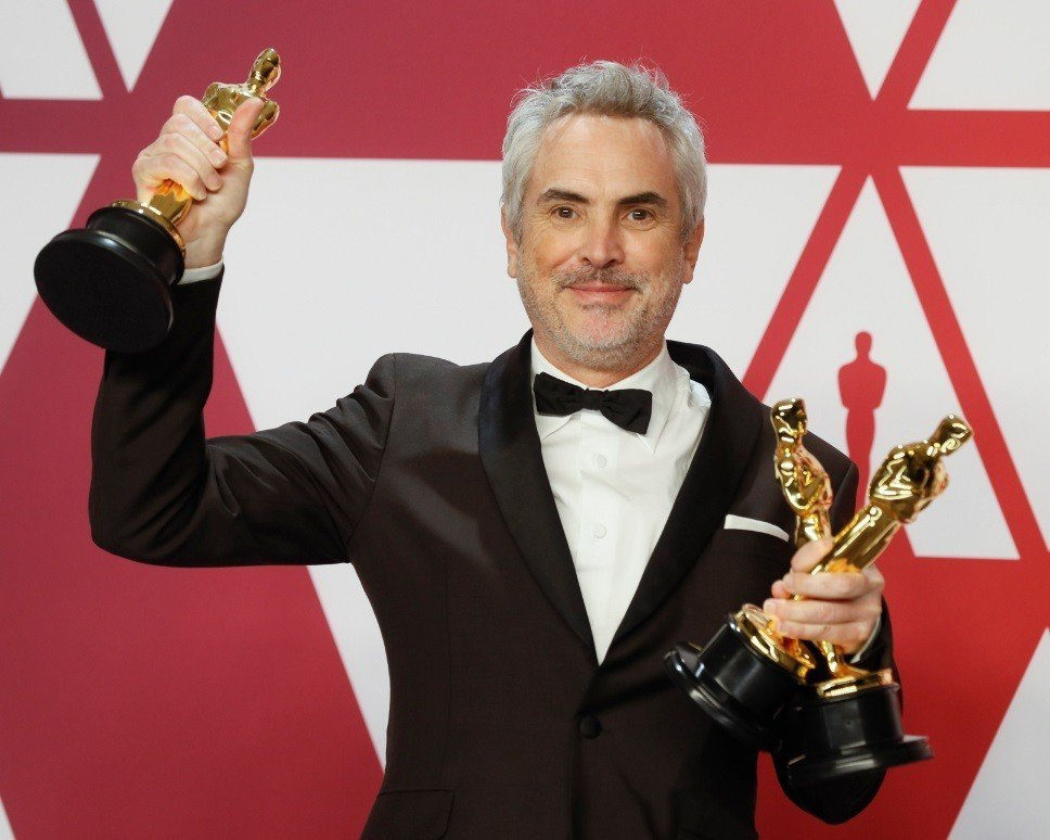 「羅馬」名導艾方索柯朗笑擁最佳外語片、導演、攝影三座小金人。圖/歐新社