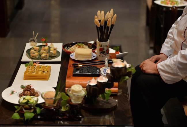 沒有動力去賺錢的時候,就去最好的餐廳吃頓飯。 法新社