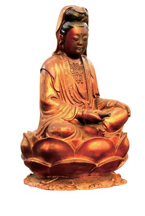 一般民間供奉的觀音菩薩塑像。(圖/擷取自柿子文化出版的《神靈臺灣》)
