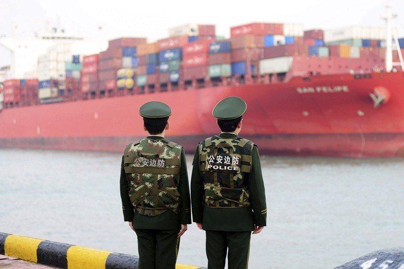 中國對此次美朝無協議感受的震驚頗大,中美貿易戰仍持續中。 圖/美聯社