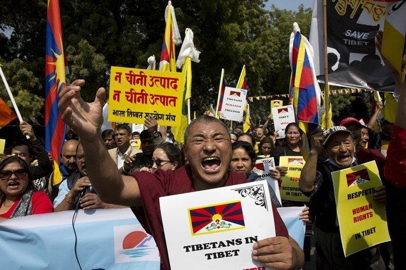 3月10日,西藏抗暴60週年大遊行,攝於印度新德里。 圖/美聯社