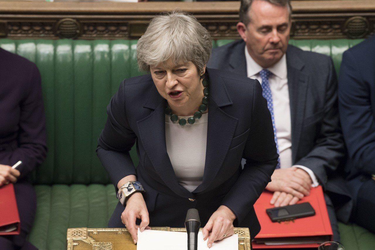 英國首相梅伊提出的脫歐協議,12日在國會下議院遭否決。(新華社)
