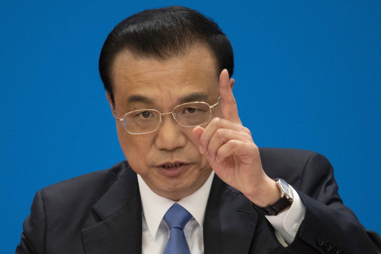 中國國務院總理李克強15日在全國人大會議閉幕後記者會回答中外記者的提問。(美聯社...
