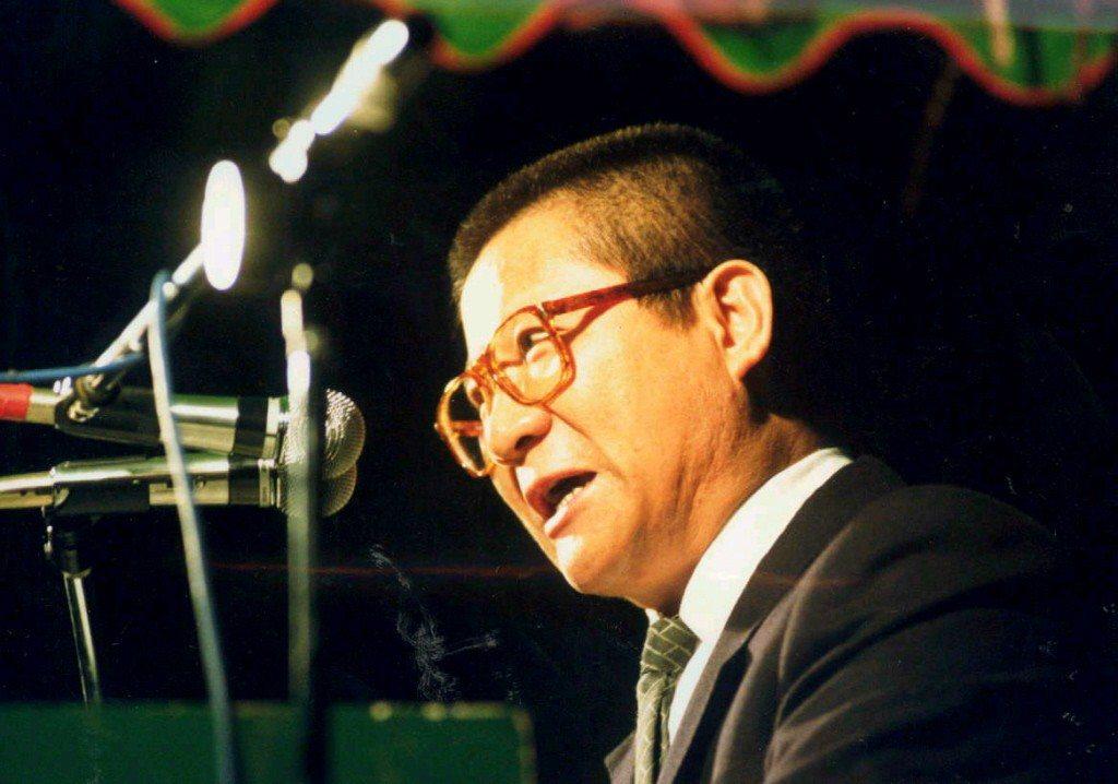 1989年,吳樂天在民進黨政見發表會中助講畫面。 圖/聯合報系資料照