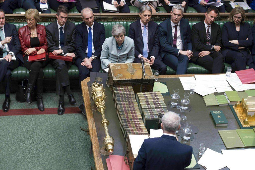 圖為英國首相梅伊在倫敦下議院,向英國下議院發表聲明情形。美聯社