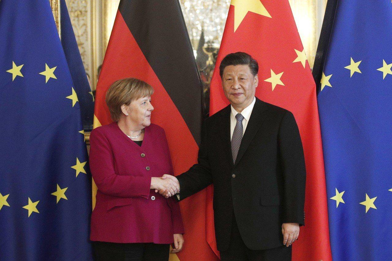 大陸國家主席習近平會見德國總理梅克爾。(歐新社)