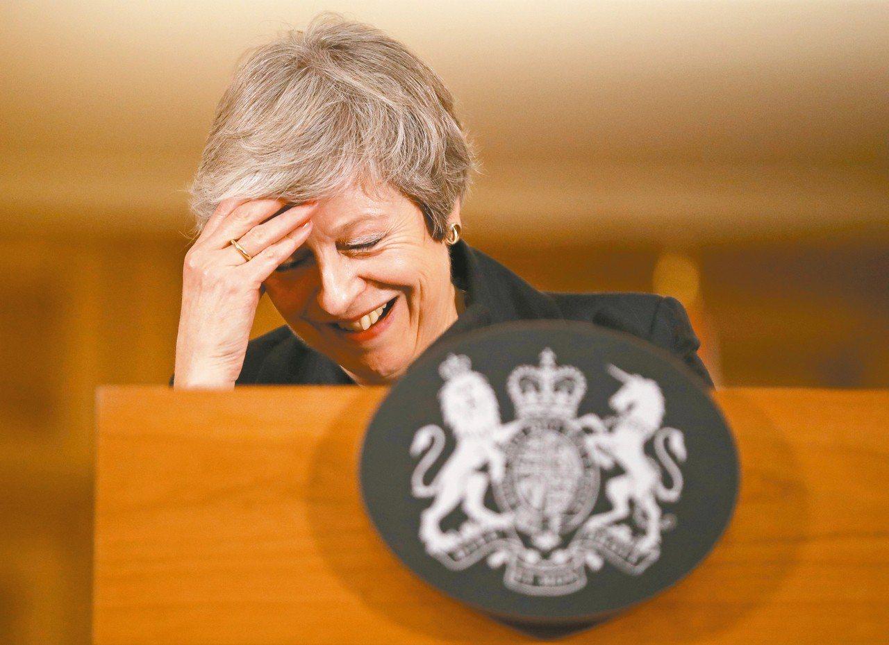英國首相梅伊願意下台,交換國會同意她的脫歐協議。 美聯社
