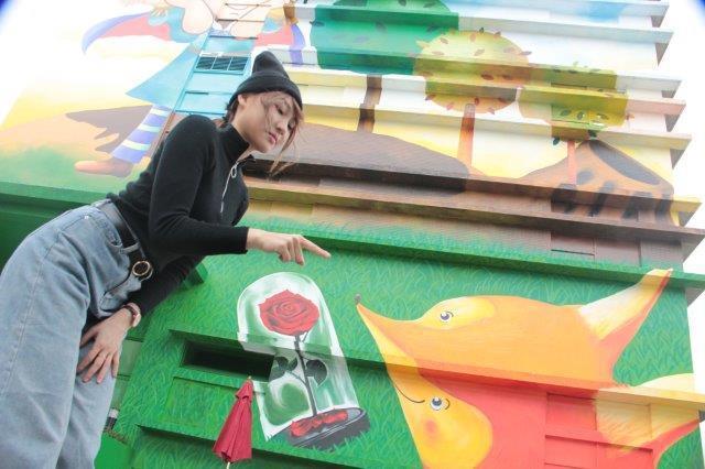 彩繪牆上可以看見狐狸、玫瑰等經典角色。圖/取自新北市政府水利局官網