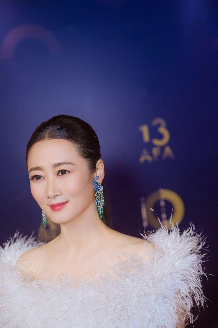 趙濤配戴蕭邦孔雀造型耳環出席第13屆亞洲電影大獎紅毯。圖/蕭邦提供