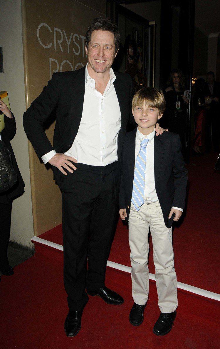 休葛蘭是伊莉莎白赫莉的兒子的教父。圖/達志影像