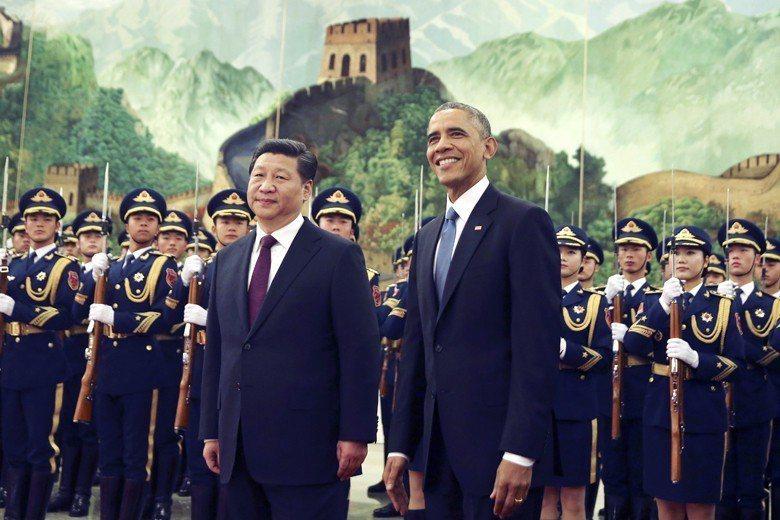 中國是否為美國處理世界問題的好夥伴?圖為2016年美國總統歐巴馬赴杭州與中國國家...