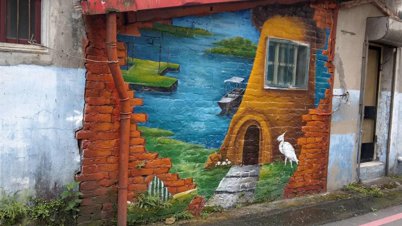 宜蘭冬山老屋的彩繪牆頗具巧思,引領遊客感受小村莊的魅力。記者戴永華/攝影