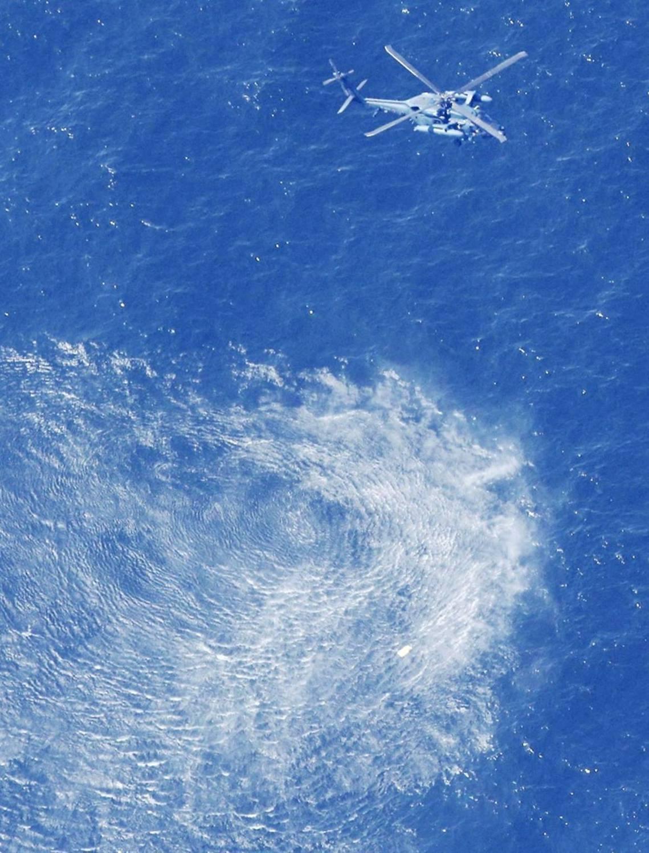 日本海上保安廳的搜救任務。 圖/路透社