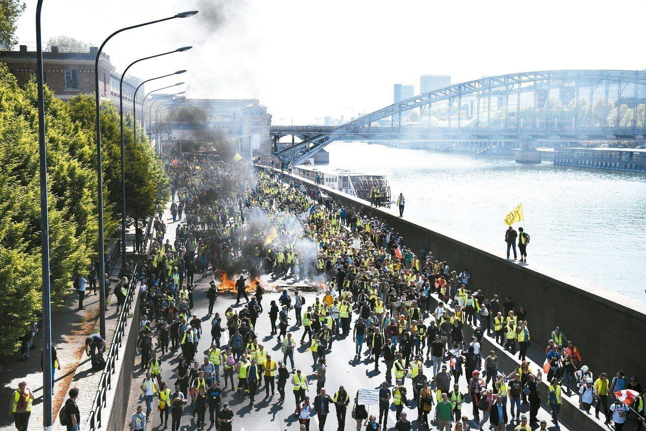 法國「黃背心」運動20日連續第23個周末上街。 歐新社