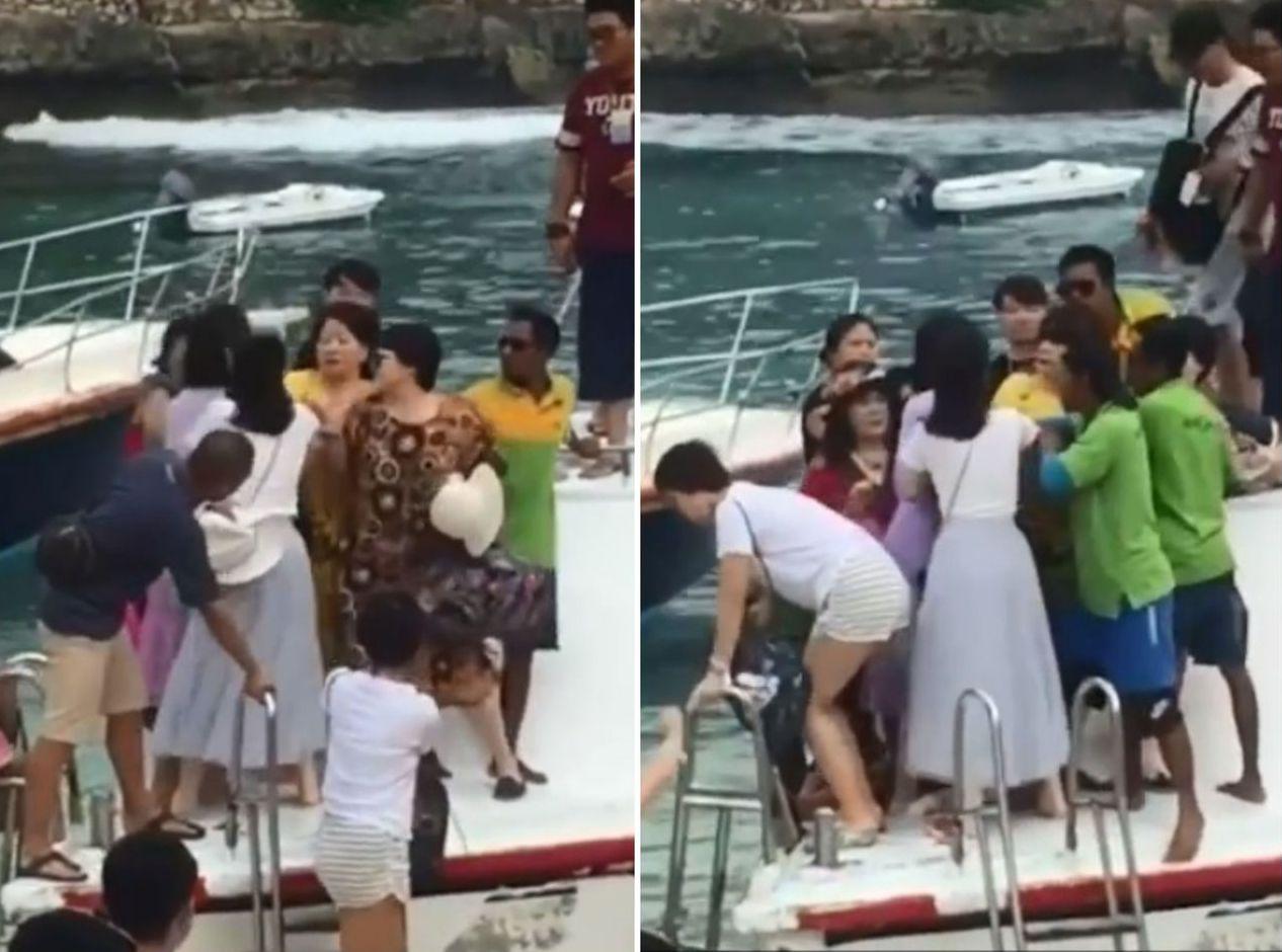 一名大媽為了搶快下遊艇,竟與同團旅客起爭執,眾人就這麼在甲板上扭打成一塊。圖片來...