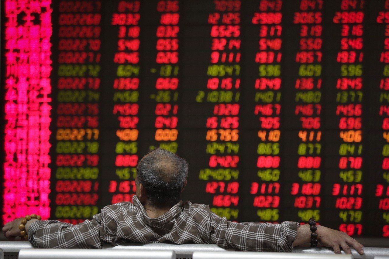 亞洲股市受激勵今天大多收漲。 美聯社