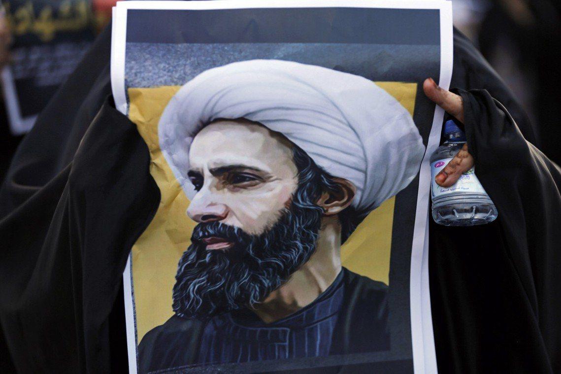 2016年被斬首的尼姆爾教長肖像。 圖/美聯社