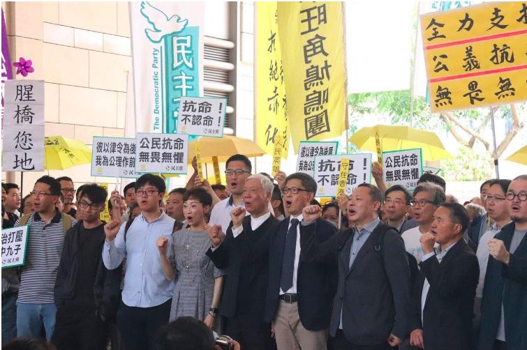 香港「占中」案9名被告今天被判刑,各人被判緩刑至入獄16個月不等。(中央社)