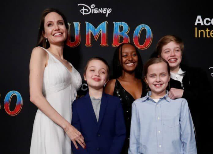 安琪莉娜裘莉開心帶孩子們看「小飛象」首映,卻有八卦刊物指照片裡這幾個孩子一毛遺產