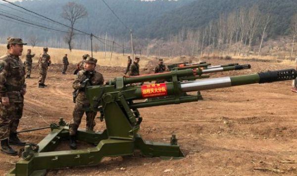 中國武器製造商「北方工業」正系列改造野戰炮,可發射滅火炮彈。圖源:中國日報