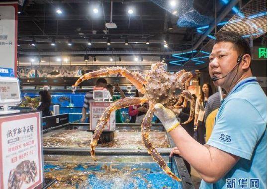 盒馬鮮生領跑生鮮市場電商交易的「新零售」。取自新華社