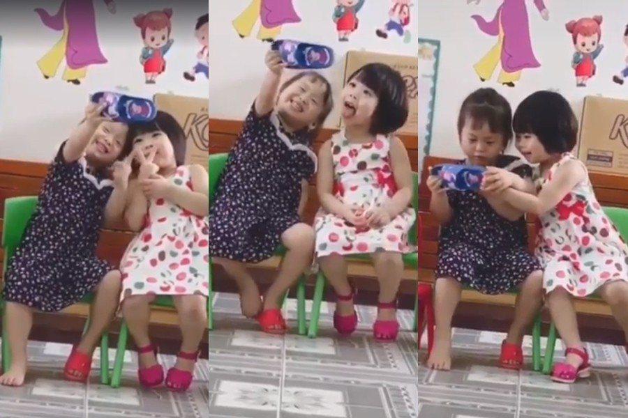 小女孩拿在手上自拍的「手機」,其實是穿在腳上的拖鞋。 圖片來源/爆笑公社