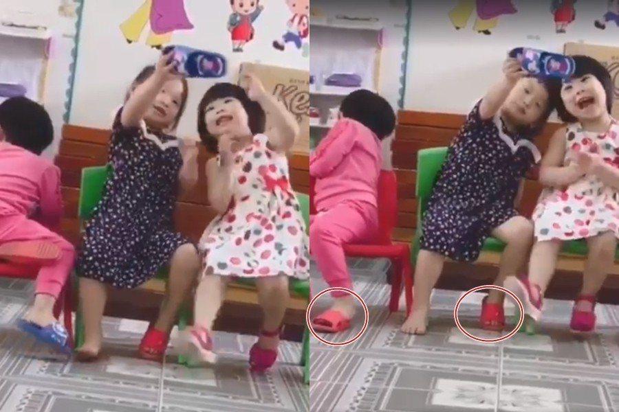 女童拿了別人的拖鞋,卻也把自己的其中一隻給同學穿。 圖片來源/爆笑公社
