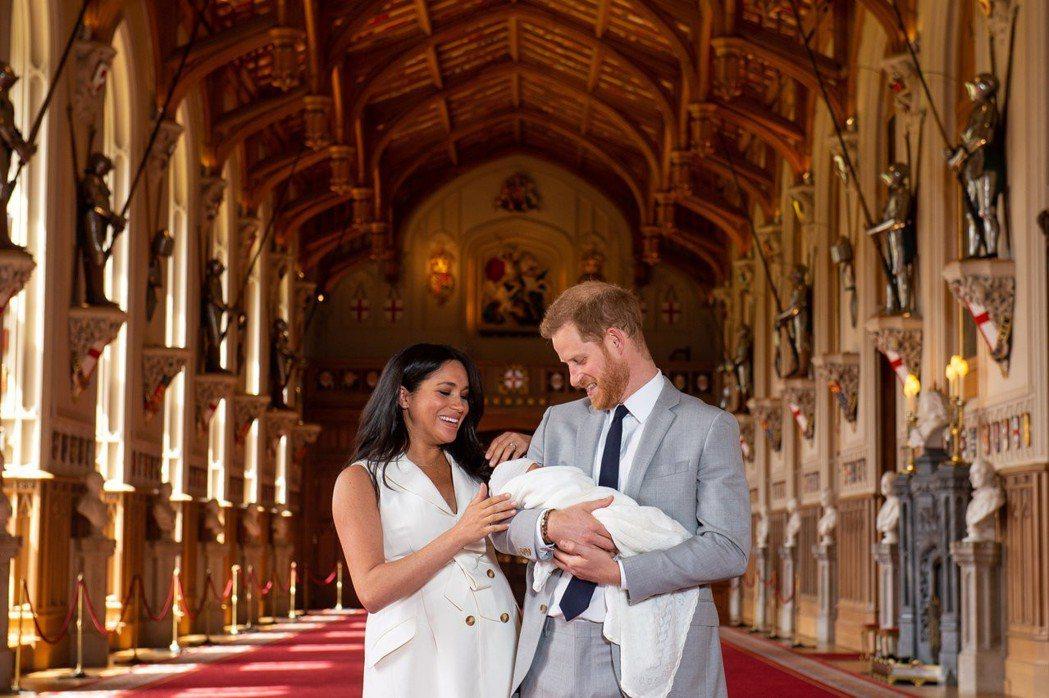 哈利王子與梅根的臉上都洋溢著幸福。圖/路透