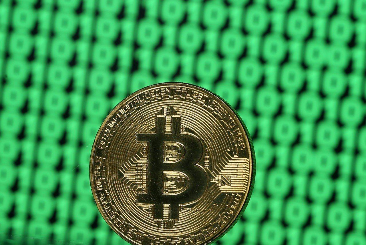 全球規模最大的加密貨幣比特幣繼週末衝上9個月來最高價。 路透
