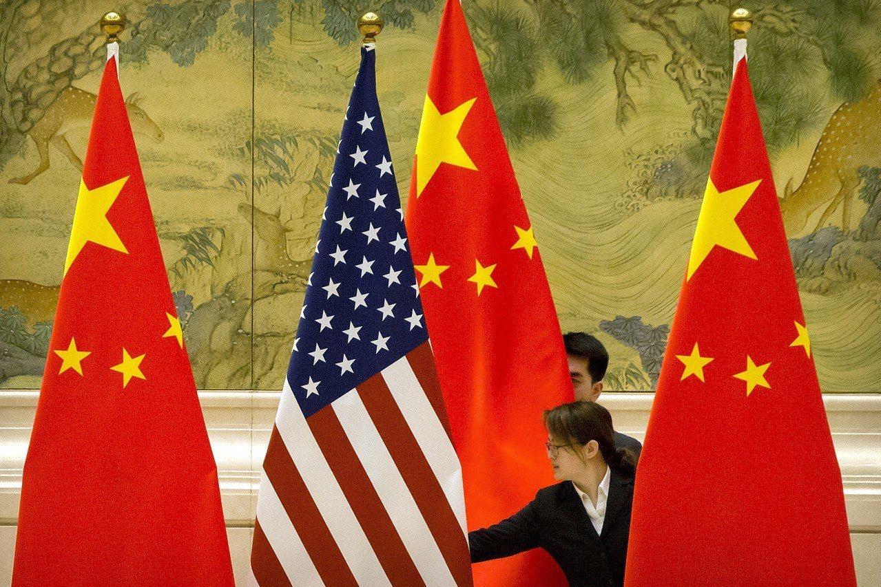 美中貿易衝突若加劇,不僅兩敗俱傷,也將拖累全球經濟。 (美聯社)