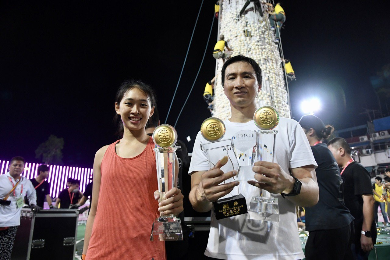 男子組參賽者郭嘉明連莊三奪「包山王」,並成為首位「包山王中王」。 香港中國通訊社
