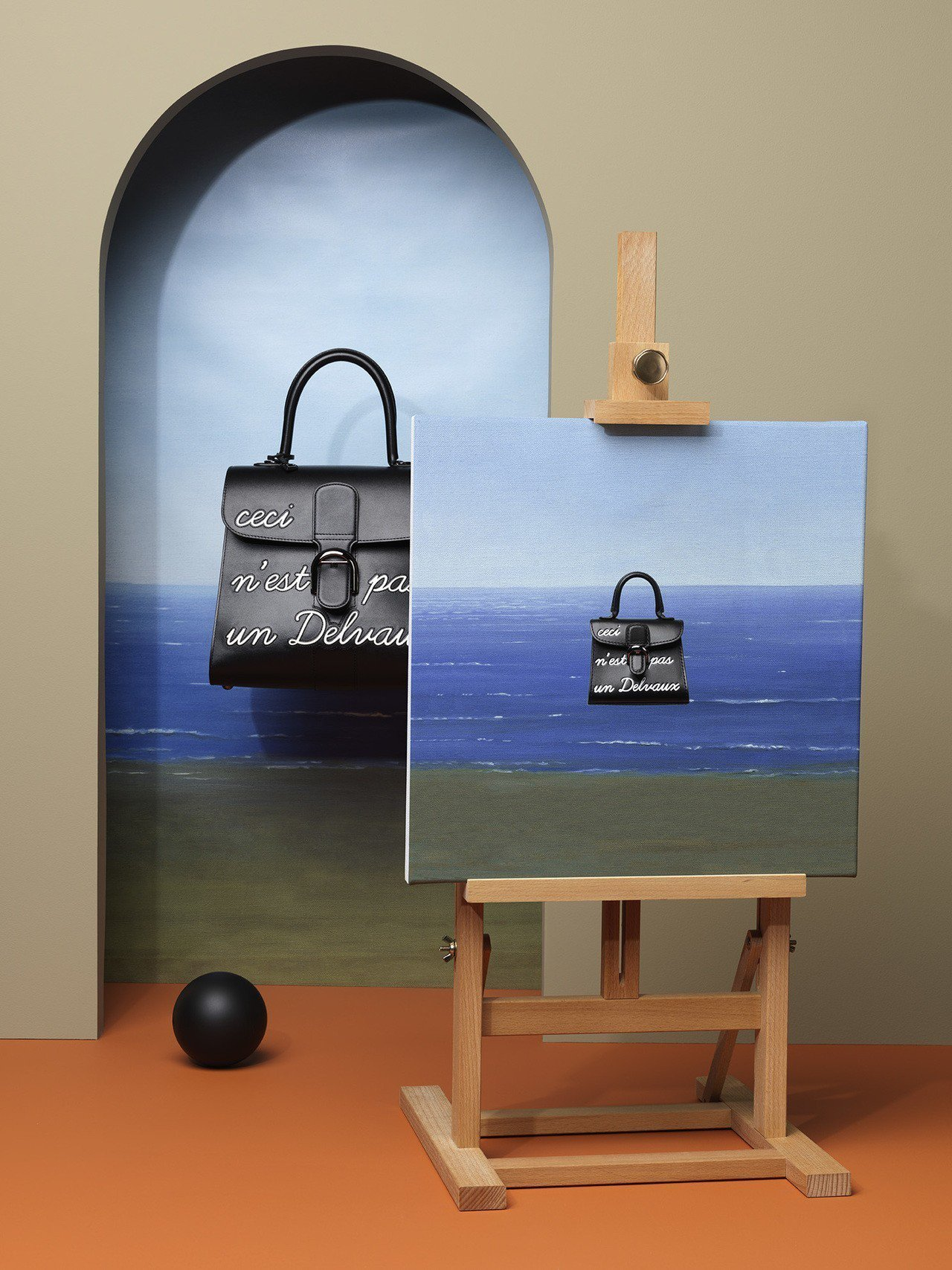 Magritte黑色L Humour中型牛皮肩背包,售價27萬7,300元。圖/...