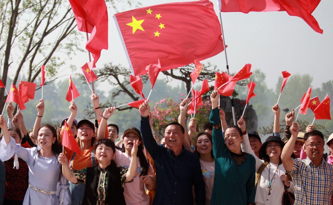 美國總統川普近日重燃中美貿易戰火,引發中國反美情結,甚至傳唱歌曲籲團結。法新社