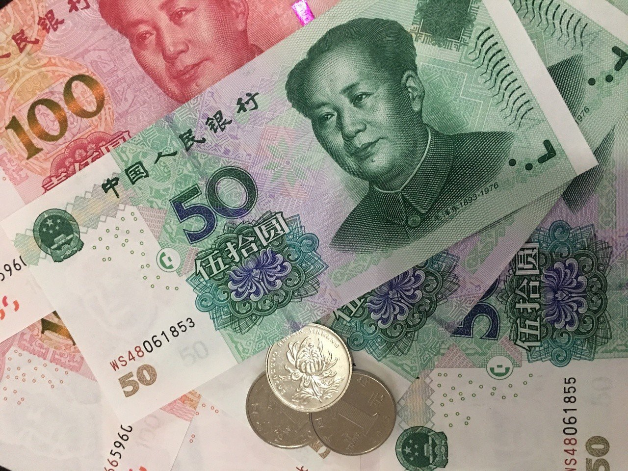 美中貿易戰不斷引發人民幣兌美元匯率是否會「破7」的討論。(本報系資料庫)