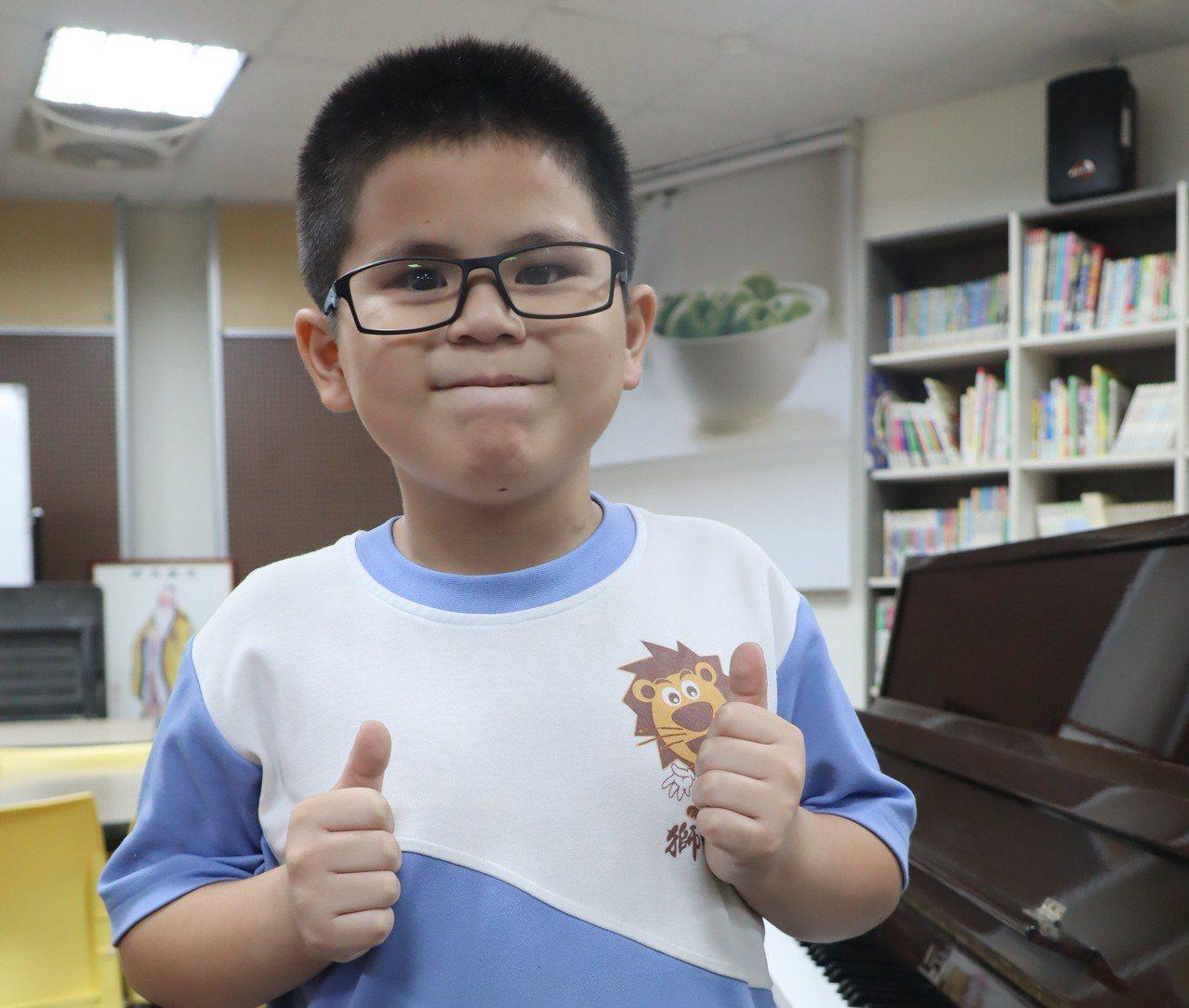 獅甲國小三年級全盲生羅柏勛未來想當總統,才有力量幫助更多需要幫助的人。記者徐如宜...