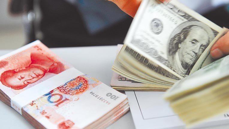 本周內,人行兩度發聲,向市場傳遞十分明確的穩匯率信號。新華社資料照片