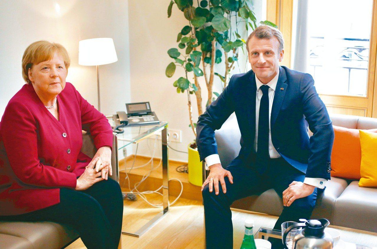 德國總理梅克爾(左)和法國總統馬克宏對歐盟執委會新任主席人選意見相左。 路透
