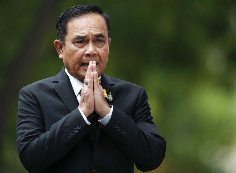 泰國國會昨天舉行總理選舉,現任總理帕拉育在參眾議院以500票對244票順利連任。 歐新社